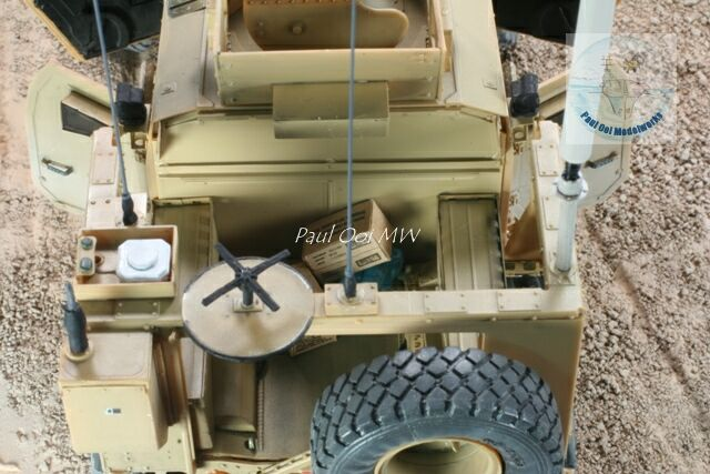 Rear compartment detail: MRE boxes and bottled water pack